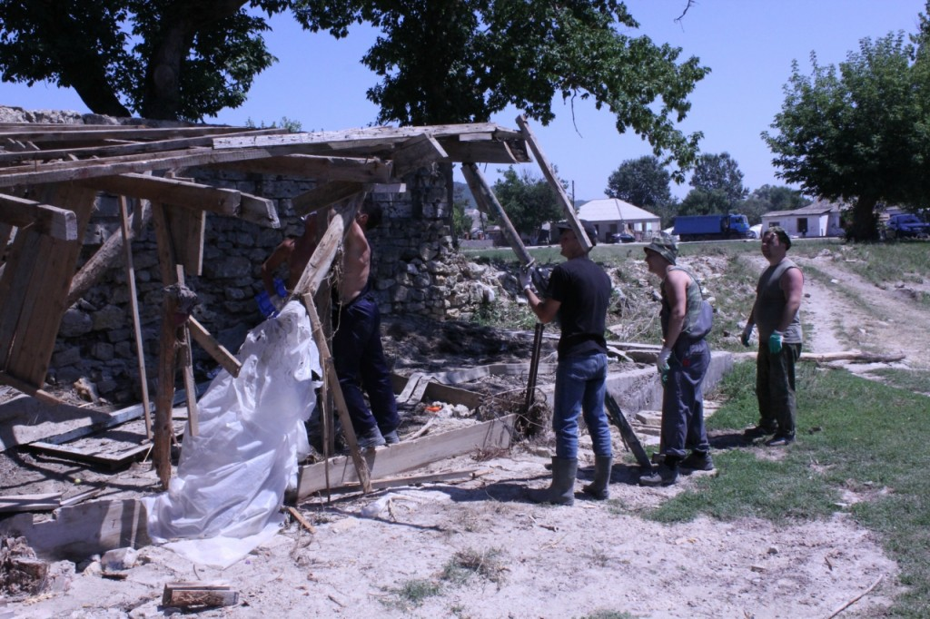 Clearing debris from the territory of private households