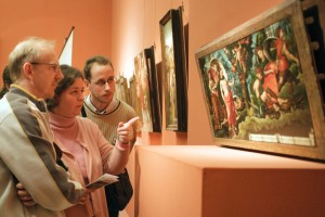 Visitors examining the painting_Hungary